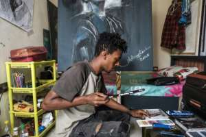 In Asmara, Nebay had an apartment and a separate studio, but these days he works out of his cramped living space on the outskirts of Addis.  By EDUARDO SOTERAS (AFP)