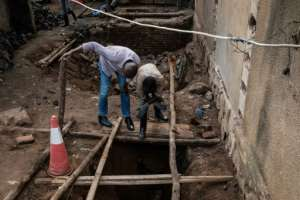 In Aptil last year, workers opened up a pit that was found to be a mass grave at Kaguba in the outskirts of Kigali. By Yasuyoshi CHIBA (AFP/File)