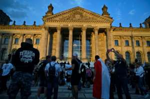 In Berlin, thousands protested against coronavirus restrictions but police later stopped the rally because many were not respecting social distancing measures.  By John MACDOUGALL (AFP)
