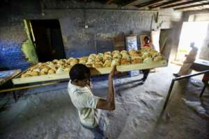 In December 2018, authorities raised the official price of a 70-gram loaf from one Sudanese pound to three, prompting a rush on bakeries and long queues.  By ASHRAF SHAZLY (AFP)