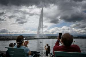 In Geneva, the famous lakefront fountain that had been switched off during the lockdown was returned to service.  By Fabrice COFFRINI (AFP)