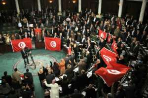 In January 2014, Tunisian lawmakers adopted a new constitution after two years of political turmoil.  By STR (AFP/File)