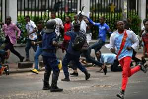 In Kinshasa, police roughly broke up a rally of pro-Fayulu supporters who had gathered near the court where the runner-up filed a request to annul the election result.  By TONY KARUMBA (AFP)