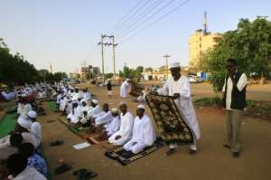 In some neighbourhoods of Khartoum Muslim worshippers ventured out to perform Eid al-Fitr prayers.  By - (AFP)