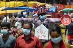 India exteded national lockdown orders for its 1.3 billion people until the beginning of May.  By Arun SANKAR (AFP)