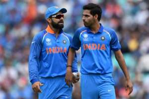 India's captain Virat Kohli (left) and India's Bhuvneshwar Kumar discuss during the ICC Champions Trophy match between South Africa and India at The Oval in London on June 11, 2017