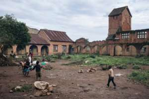Internally displaced children play in the courtyard of the Minor Seminary, destroyed during the Ituri War (1999-2003), in Fataki.  By ALEXIS HUGUET (AFP)