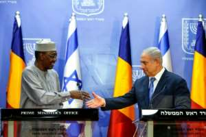 Israeli Prime Minister Benjamin Netanyahu (R) shakes hands with Chadian President Idriss Deby Itno at a joint statements in Jerusalem November 25, 2018.  By RONEN ZVULUN (POOL/AFP/File)