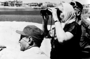 Israeli Prime Minister Golda Meir looks over to the Egyptian side of the Suez Canal in 1970, during the war.  By RADIOPHOTO (AFP)
