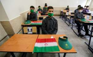 Iran resumed the school year after nearly six months.  By ATTA KENARE (AFP)