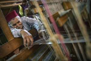 It takes a day to weave a metre (three feet) of brocade at Ouazzani's workshop in Fes.  By FADEL SENNA (AFP)