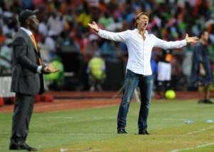 Zambia's head coach Herve Renard (R) reacts next to Ivory Coast's head coach Francois Zahoui.  By Franck Fife (AFP)