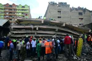 It is not clear how many people were in the building at the time, or how many may still be trapped, but there were 57 units in the structure.  By Simon MAINA (AFP)
