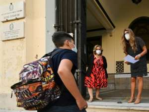 Italian children were among the first in Europe to see their schools closed, and some 5.6 million returned for the first time in six months.  By Vincenzo PINTO (AFP)