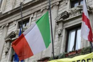 Italian flags were flying at half-mast.  By Miguel MEDINA (AFP)