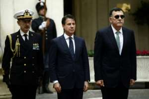 Italy's Prime Minister Giuseppe Conte (C) met his Libyan counterpart Fayez al-Sarraj in Rome in October.  By Filippo MONTEFORTE (AFP/File)