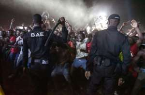 Ivorian riot police used truncheons and tear gas to contain the crowd. By Sia KAMBOU (AFP)