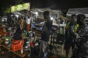 Ivory Coast has detained 450 for failing to respect curfew.  By ISSOUF SANOGO (AFP/File)