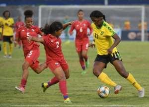 Jamaican striker Khadija Shaw (R) is one of the stars of the Reggae Girlz.  By Angela Weiss (AFP)