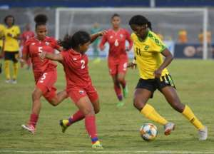 Jamaican striker Khadija Shaw (R) is one of the stars of the Reggae Girlz.  By Angela Weiss (AFP)