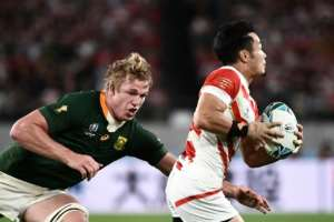 Japan wing Kenki Fukuoka runs to evade South Africa flanker Pieter-Steph Du Toit in the quarter-finals.  By Anne-Christine POUJOULAT (AFP/File)