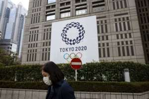 Japan's government was forced to dismiss another report casting doubt on the Tokyo Olympics going ahead this year.  By Behrouz MEHRI (AFP)