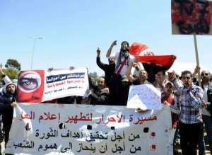 Supporters of the Islamist party Ennahdha protest in front of the Tunisian television headquarters on April 24.  By Fethi Belaid (AFP/File)