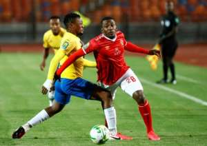 Junior Ajayi (R) completed the scoring for Al Ahly in a convincing Egyptian Premier League victory over ENPPI..  By Khaled DESOUKI (AFP)
