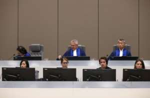 Justice: The International Criminal Court at Monday's verdict. Head judge Robert Fremr is in the centre of the back row.  By EVA PLEVIER (POOL/AFP)