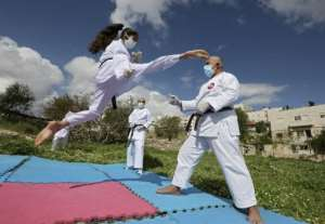 Karate training in the Palestinian territories -- with masks.  By HAZEM BADER (AFP)