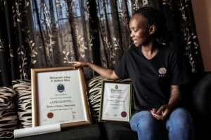 Kgomotso Sebabi, a South African unemployed graduate shows her higher education certificate. By GIANLUIGI GUERCIA (AFP)