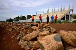 Kenyan athletes warm up along a section of the track at the historic Kamariny stadium in Iten, which is unergoing reconstruction ahead of next year's world junior championships.  By TONY KARUMBA (AFP)