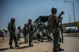 Kenyan police arrive to break up a protest from opposition supporters in Kisumu, western Kenya, on August 9, 2017