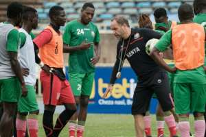 Kenya's French head coach Sebastien Migne speaks to players during a training session ahead of the 2019 Africa Cup of Nations.  By Yasuyoshi CHIBA (AFP)