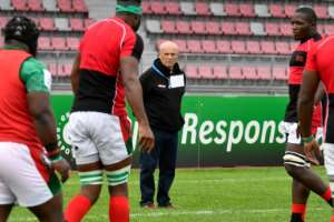 Kenya's head coach Ian Snook (C), who only took up his position in April, sees potential if there is investment in rugby in the country.  By GERARD JULIEN (AFP/File)