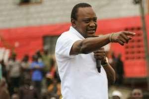 Kenya's President Uhuru Kenyatta has said the election re-run will go ahead, whether his challenger Raila Odinga participates or not