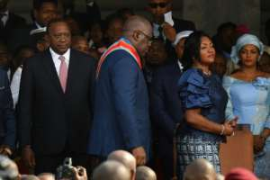 Kenya's Uhuru Kenyatta, seen next to Felix Tshisekedi at the latter's inauguration last month, offered to share lessons learned from his own country's past political tensions as Tshisekedi looks to forge DR Congo's future after his disputed poll win.  By TONY KARUMBA (AFP)