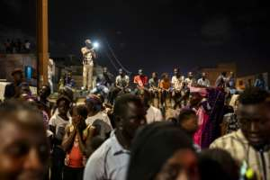 Khalifa Sall's supportrs hailed his convoy as it crossed several neighbourhoods of the capital.  By JOHN WESSELS (AFP)