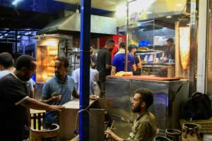 Khartoum residents flock to restaurants serving Syrian delicacies, making it often hard to find a table at restaurants in the Sudanese capital's Kafouri district.  By Ebrahim HAMID (AFP/File)