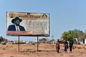 Kiir, whose image smiles from a billboard urging national dialogue, says he is ready to form a government, but the international community has warned him against doing so without Machar.  By TONY KARUMBA (AFP)