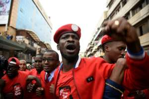 Kyagulanyi, better known as Bobi Wine, pictured on July 11 at a protest in Kampala over plans to impose a tax on social media. The 36-year-old singer was elected to Uganda's parliament last year.  By Isaac Kasamani (AFP/File)