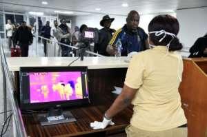 Lagos international airport has heightened screening, one of Nigeria's preventative measures.  By PIUS UTOMI EKPEI (AFP)