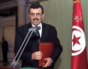 Prime Minister-designate Ali Larayedh arrives to give a press conference on March 7, 2013 in Tunis.  By Fethi Belaid (AFP)