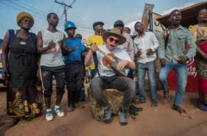 Lazarus Chigwandali, performing in Lilongwe's Area 3 Market, says he hopes his music