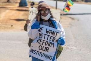 Leading novelist Tsitsi Dangarembga was arrested after she held up an anti-corruption placard by the roadside.  By ZINYANGE AUNTONY (AFP)