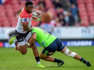 Lions' Aphiwe Dyantyi is tackled by Highlanders' Ash Dixon.  By Christiaan Kotze (AFP)