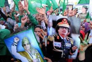 Libyan supporters of Moamer Kadhafi rally in Tripoli in July 2011.  By Mahmud Turkia (AFP/File)
