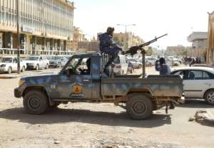 Libya has been torn between rival groups since dictator Moamer Kadhafi was overthrown in 2011 -- among them forces loyal to strongman Khalifa Haftar like these on patrol in the southern city of Sebha.  By - (AFP)