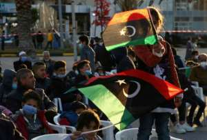 Libyan children wave national flags at an anniversary military parade in the Mediterranean port city of Tajura.  By Mahmud TURKIA (AFP)