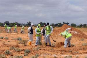 Libyan experts search for human remains on June 23 in an area southeast of Tripoli seized by the unity government from forces loyal to eastern strongman Khalifa Haftar.  By Mahmud TURKIA (AFP/File)